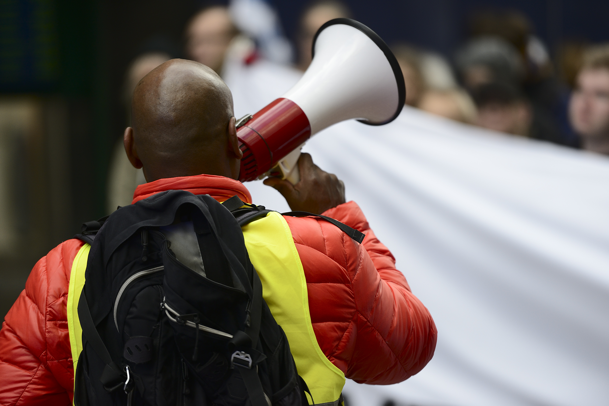 Man with megaphone at industrial action