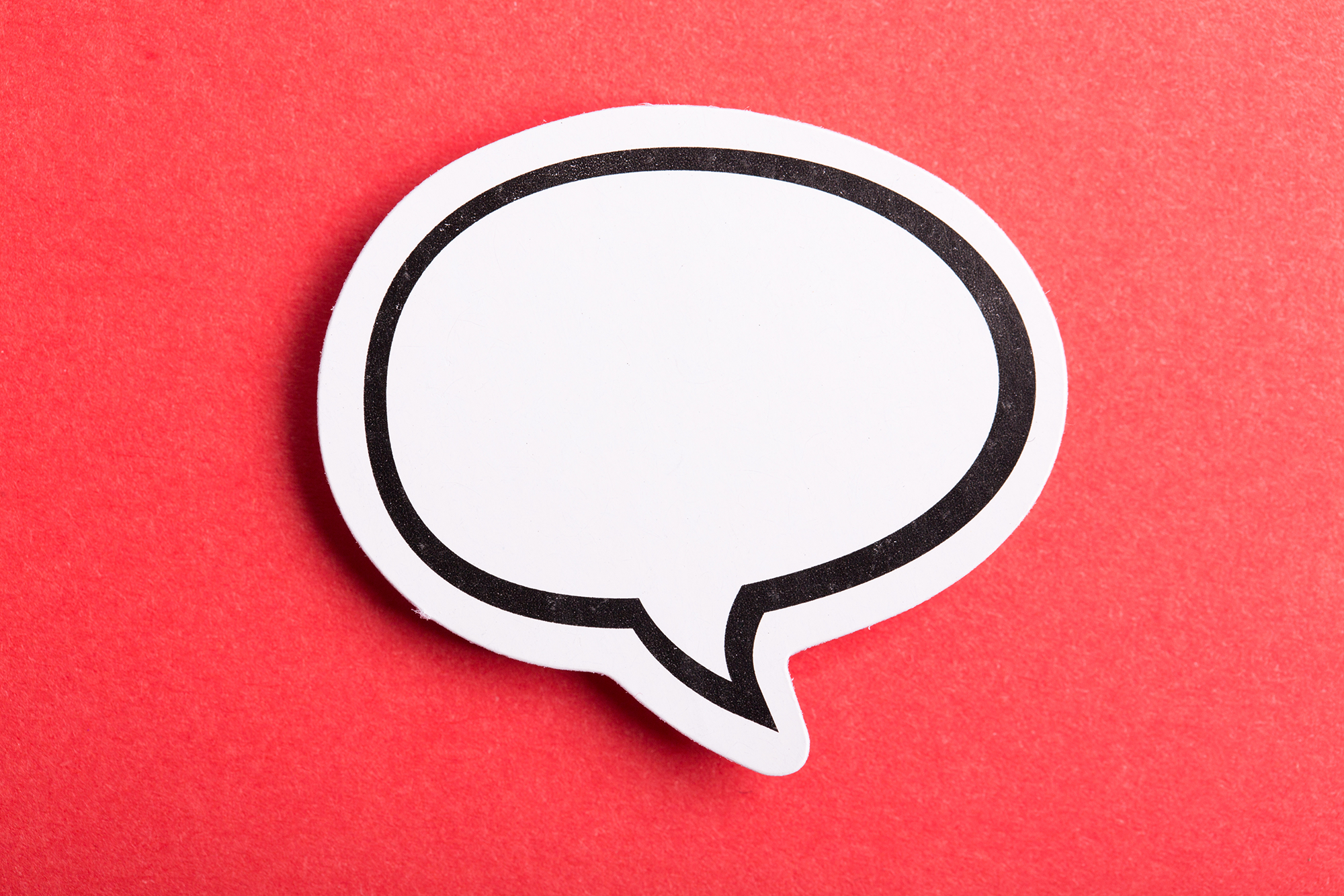 Speech bubble on a red background